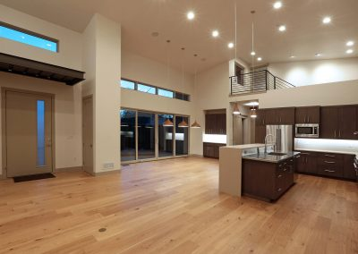 Urban Living: open living space with sliding glass doors to private patio