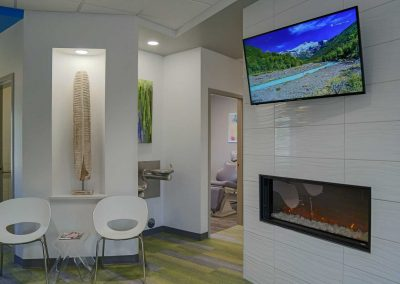 Smiles For Colorado - waiting area with fireplace