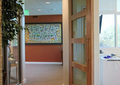 Rock Dental: hallway with barn-style doors